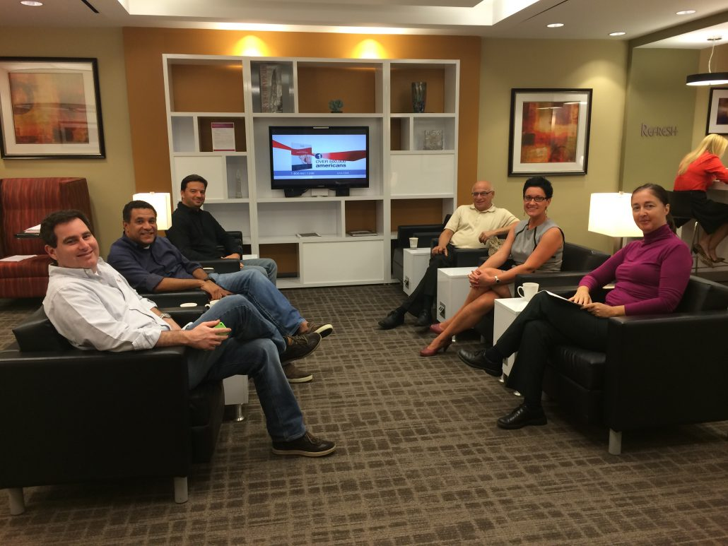Socializing During Coffee Break In The Business Lounge